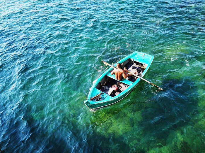High angle view of people in boat at sea
