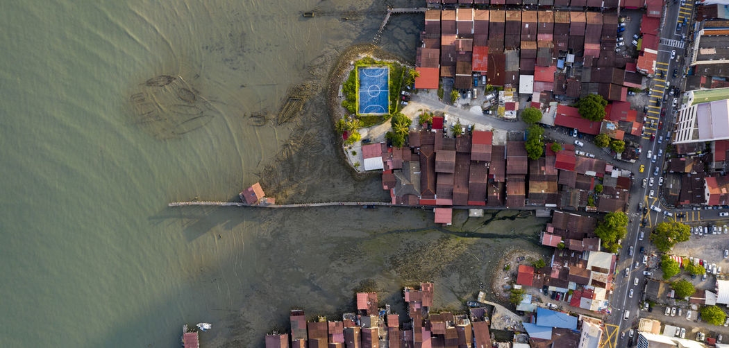 High angle view of boats in sea against buildings