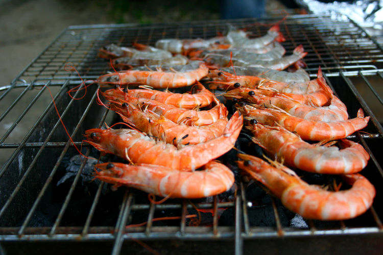 Close-up of shrimp on barbecue grill