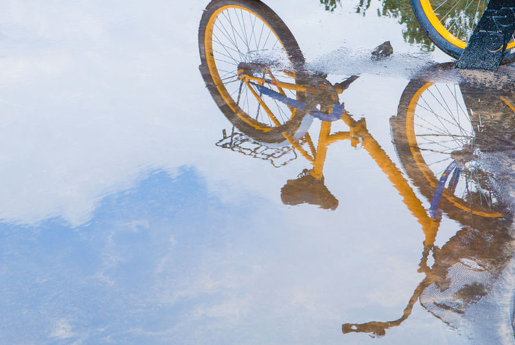 The reflection of the bike in the water Bicycle Cold Temperature Day Lake Land Vehicle Mode Of Transportation Nature No People Outdoors Puddle Reflection Sky Snow Transportation Water Waterfront Wheel Winter