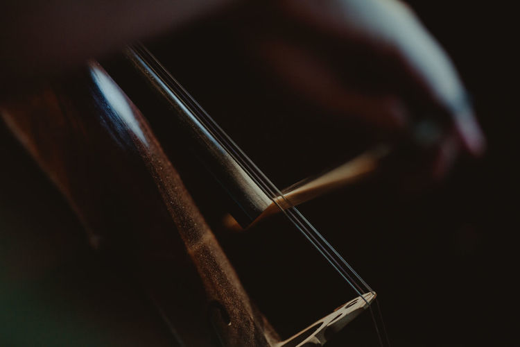 Cropped image of hand playing violin