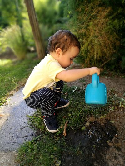 Nature People People Photography Baby Babyboy Baby Boy Kid Child Childhood Full Length Playing Grass Toddler  12-23 Months Watering Can