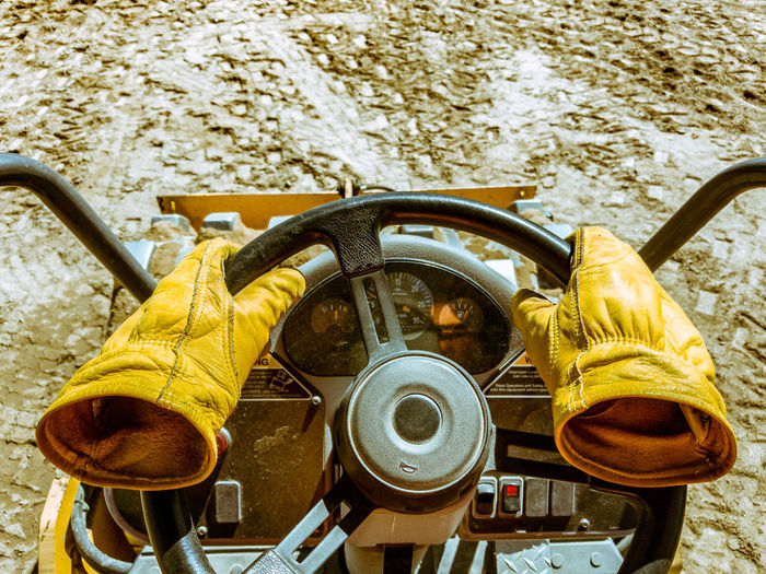 Empty gloves driving tractor