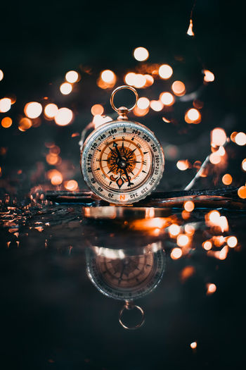 Show me the direction Compass EyEmNewHere EyeEm Best Shots Low Light Bokeh Light EyeEm Selects Tree Water Hanging Reflection Sky Close-up Geometric Shape