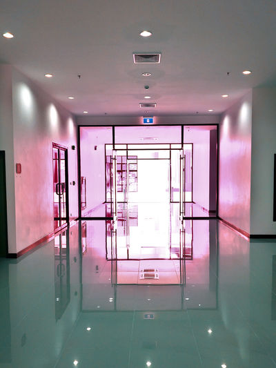 Arcade Architecture Building Built Structure Ceiling Clean Door Electric Light Empty Entrance Flooring Glass - Material Illuminated Indoors  Light Lighting Equipment Modern No People Pink Color Purple Reflection Tiled Floor Wall - Building Feature