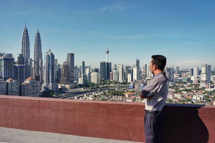 Skyline Malaysia Kuala Lumpur Skyscraper City Urban Skyline Cityscape One Person Adults Only Modern Standing People Adult Outdoors Day One Man Only Architecture Building Exterior Sky Growth Vacations Business Go Higher