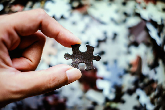 Creativity Answer Concept Connection Focus On Foreground Game Holding Human Body Part Human Finger Human Hand Idea Jigsaw  Jigsaw Puzzle Join Part Puzzle  Toy
