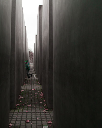 Memorial to the Murdered Jews of Europe Architecture_collection Architecture Architectural Feature Architectural Detail Concrete Concrete Wall Grey Street Photography One Person Tinypeopleinbigplaces One Man Only City Life City Running Memorial Berlin Built Structure Architectureandpeople Autumn No People Shades Of Winter