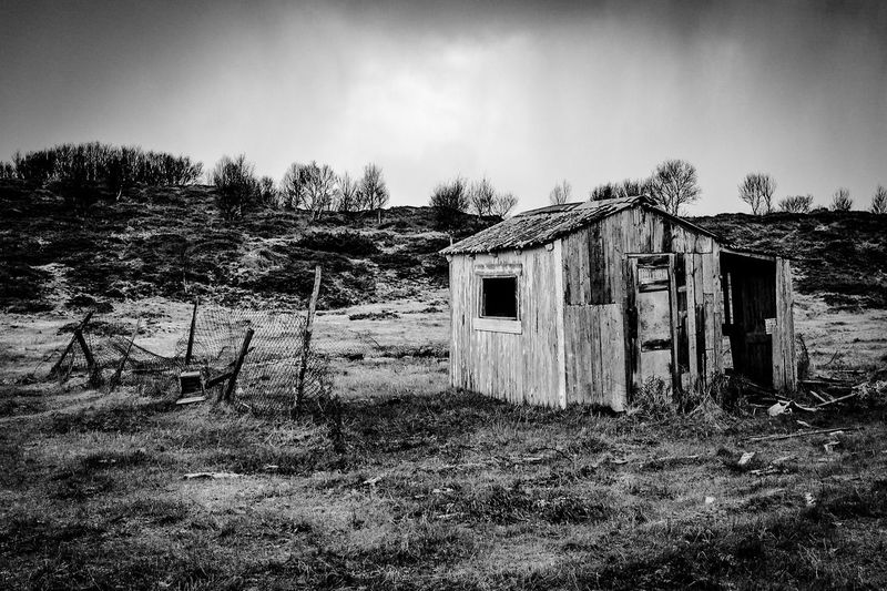 Abandoned house on field
