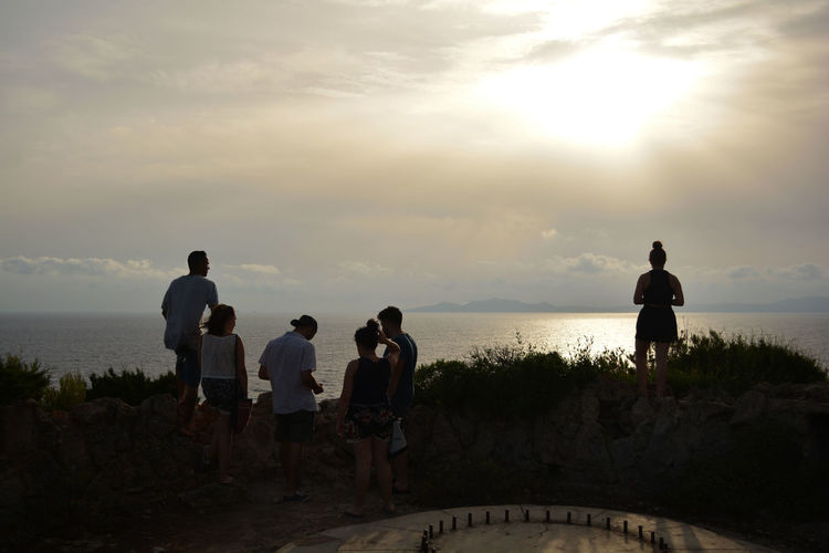 Friendship The Great Outdoors - 2018 EyeEm Awards Santadi Sardegna Sardegnaofficial Island Friendship Togetherness Party - Social Event Standing Beach Water Silhouette Sunset Fun Men