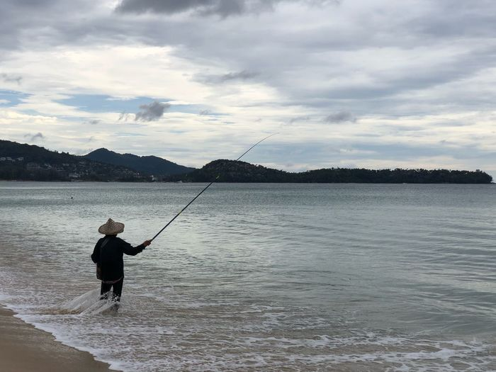 The man fishing at sea. Fishing Life Thai Woman Fishingman Water Sky Fishing Cloud - Sky Fishing Rod Rod One Person Activity Nature Leisure Activity Beauty In Nature Fisherman Outdoors Men Day Scenics - Nature