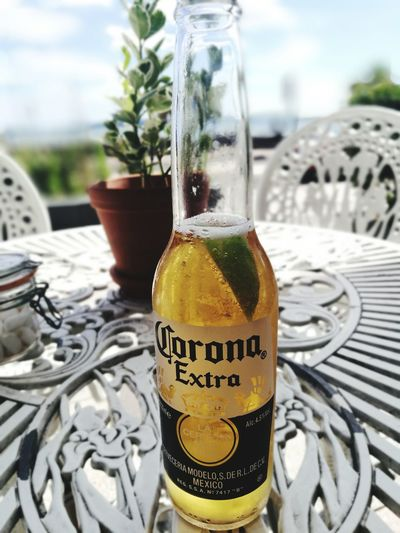 Corona Drink Alcohol Freshness Bottle Day Beer Time Cilling Time Outdoors Text Close-up Drinking Glass No People Food And Drink