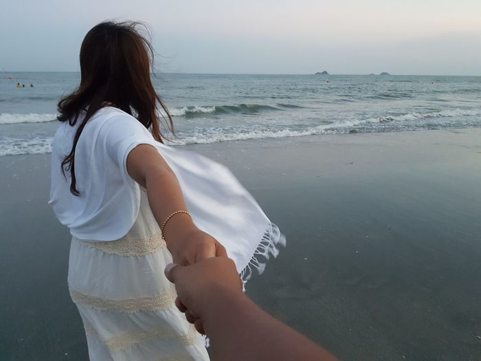 lover or couple hold hand and travel together EyeEm Selects Only Women Rear View Beach One Woman Only Adult Adults Only One Person Sea Vacations Water People Human Body Part Leisure Activity Tranquility Relaxation Women Sand Mid Adult Young Adult Standing
