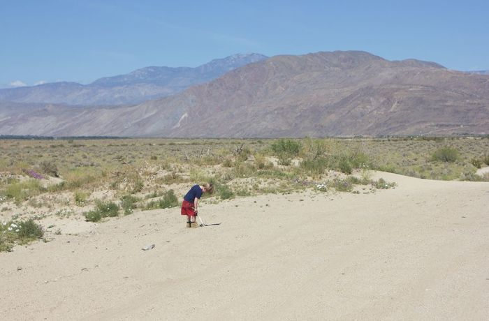 boy standing on side of deserted road Arid Climate Clear Sky Day Desert Landscape Mountain Nature One Person Outdoors People Real People Sand Scenics Sky Breathing Space Lost In The Landscape Connected By Travel Be. Ready. An Eye For Travel California Dreamin