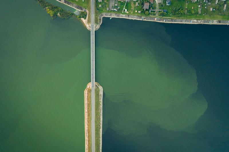 Aerial drone photo of modern bridge crossing deep blue lake. abstraction.
