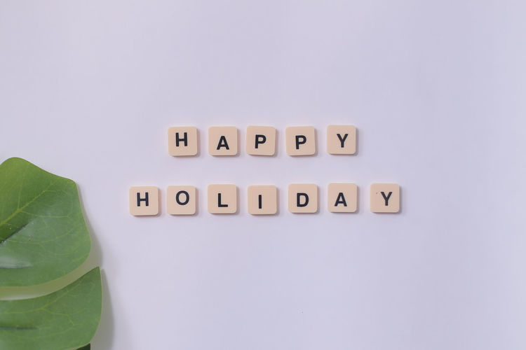 Happy Holiday Text Indoors  Western Script Studio Shot Copy Space Communication No People White Background Still Life Close-up Leaf Plant Part Green Color Capital Letter Food And Drink Cut Out Side By Side Freshness Table Food EyeEmNewHere EyeEm Best Shots Holiday Wording School Holidays Holiday Moments