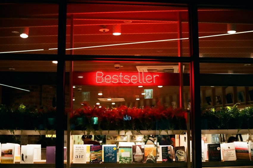 Best of best Minolta X700 Minolta Bestsellers Bookstore Retail  Text Store Night Consumerism Communication Indoors  Choice Business No People Neon EyeEmNewHere Editor's Picks