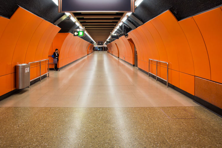 #Hong Kong #Metro #hongkong #tube The Week On EyeEm Architecture Built Structure Illuminated Indoors  Metro Station Modern One Person Orange Color People Real People Subway Station The Way Forward Transportation Underground Walkway