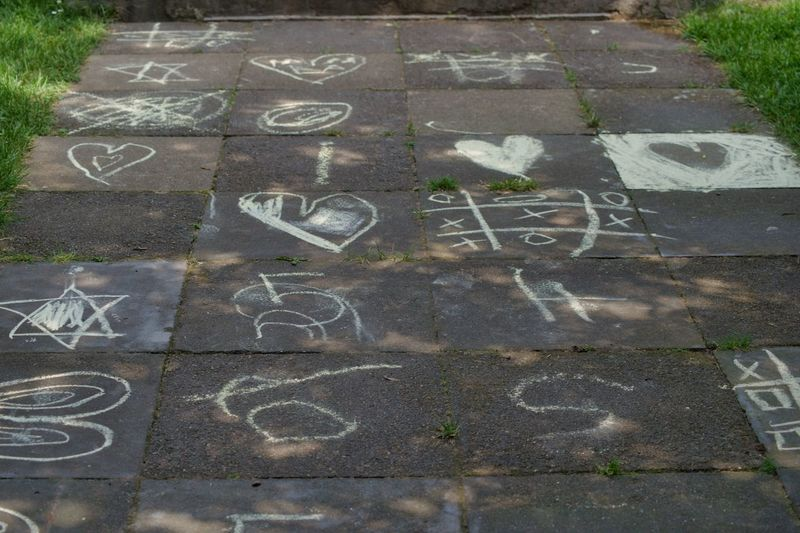 Berlin Frohnau Art And Craft Capital Letter Chalk - Art Equipment Chalk Drawing Children Drawing City Communication Creativity Day Drawing - Art Product Footpath Graffiti High Angle View Hopscotch Message No People Number Outdoors Road Sign Text Western Script
