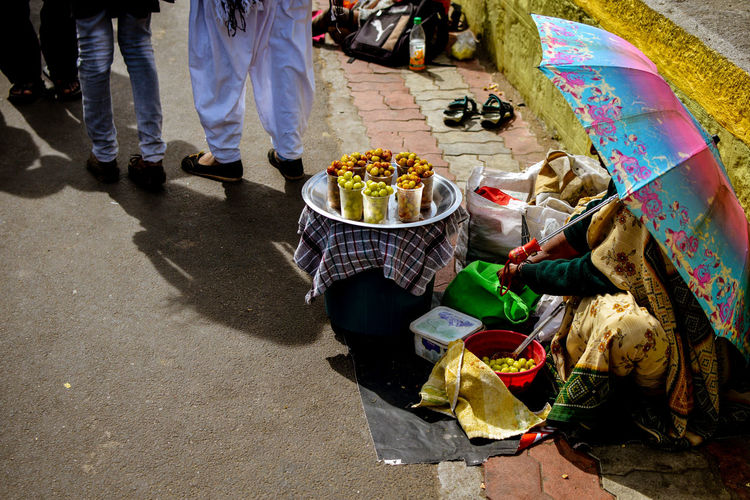 High angle view of woman selling food in market