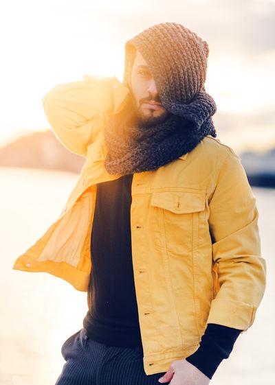 Portrait of man wearing headscarf standing outdoors