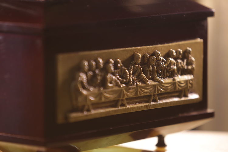 urn of wood for ashes, with image of the last supper Death Devotion Faith God Jesus Christ Last Supper New Life Pray Antique Apostle Ashes Funeral Ceremony History Our Father In Heaven Religion Religion And Beliefs Sad Time To Die Urns