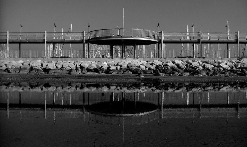 Reflection Of Bridge On Sea
