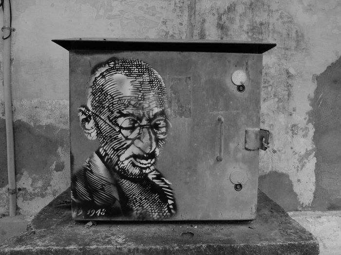 Portrait of man wearing sunglasses against wall