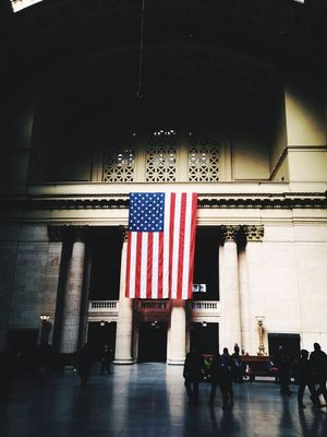 Flag Hanging over Entrance at Chicago's Union Station Commuters Pride Union Station Chicago Flag Striped People Architecture Indoors  Real People Group Of People