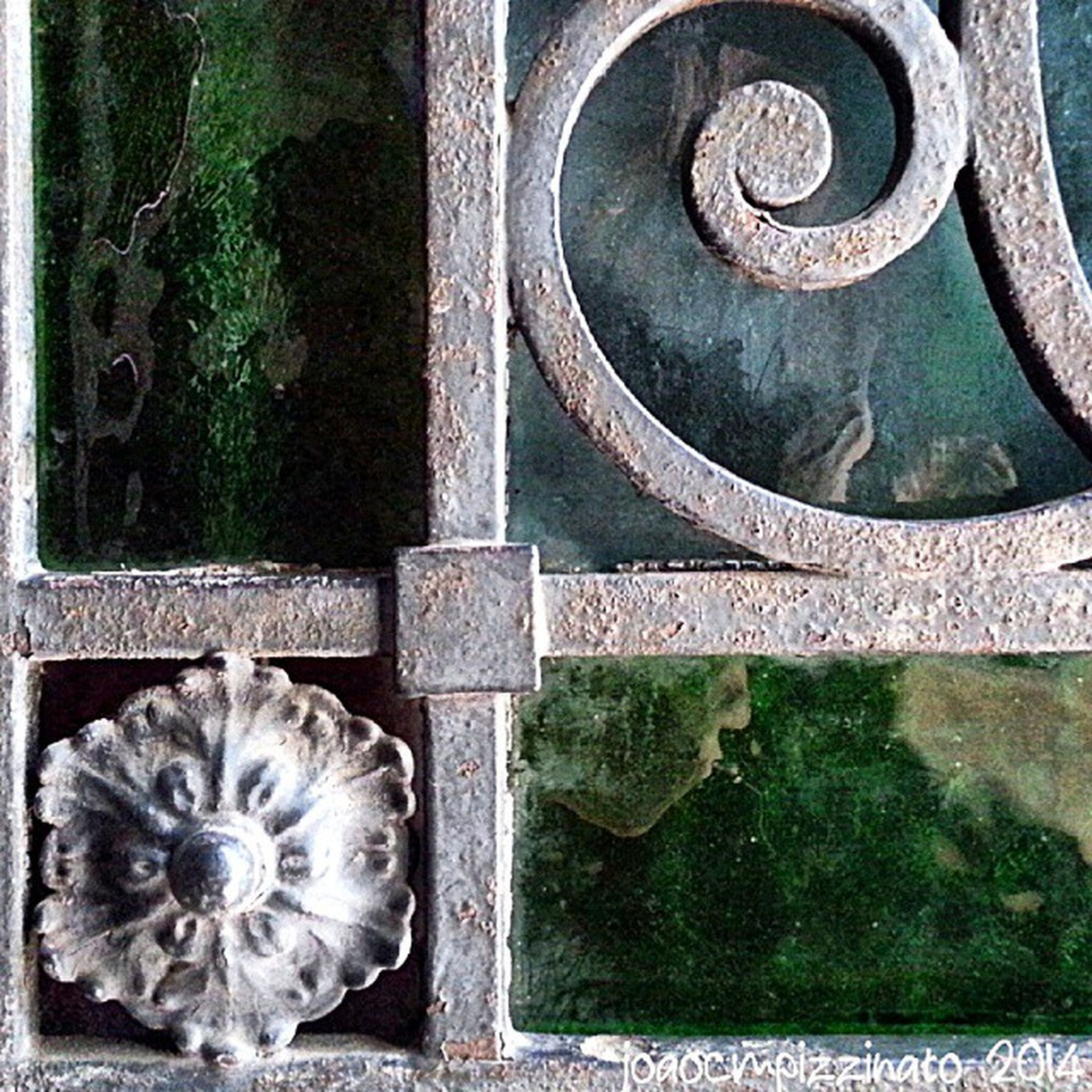 close-up, metal, plant, built structure, old, outdoors, day, no people, wood - material, park - man made space, railing, art, art and craft, front or back yard, growth, flower, circle, rusty, gate, architecture