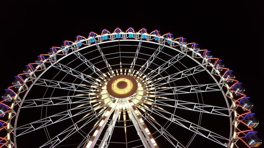 Amusement Park Ride Amusement Park Ferris Wheel Illuminated Night Arts Culture And Entertainment Sky Low Angle View No People Shape Clear Sky Glowing Carnival Outdoors Traveling Carnival Architecture Circle Nature Geometric Shape Motion