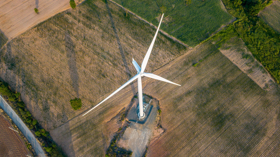 High angle view of windmill on field