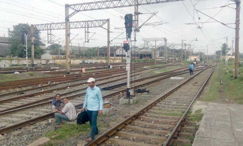 People working on railroad tracks