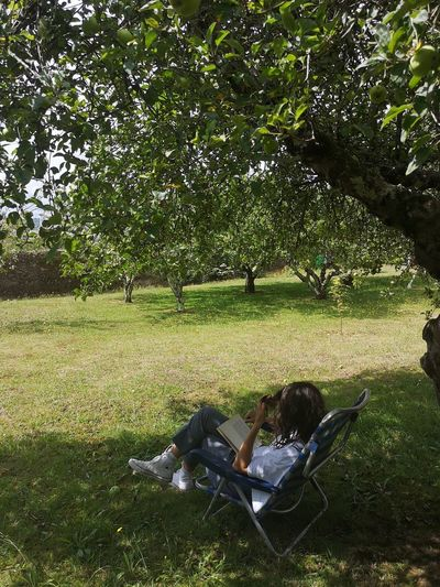 Woman relaxing on field