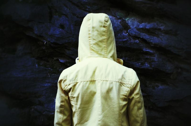 Rear View Of Person Wearing Hood