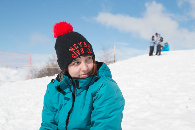 Woman wearing winter clothing in snowy mountain
