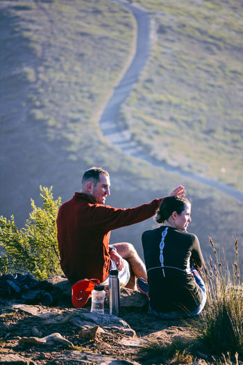 Casual Clothing Couple Focus On Foreground Hiking Leisure Activity Lifestyles Nature Road Side View Sitting