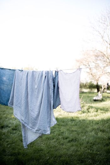 Laundry Day Drying Hanging Laundry Clothesline Clothing Front Or Back Yard No People Sheet Chores Clothespin Textile Grass Outdoors Freshness Day Structures & Lines Countryside Country Life Country Living Countryside Life Countrylife Everyday Lives Everyday Daily Life