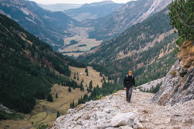 Rear view of man on mountain range