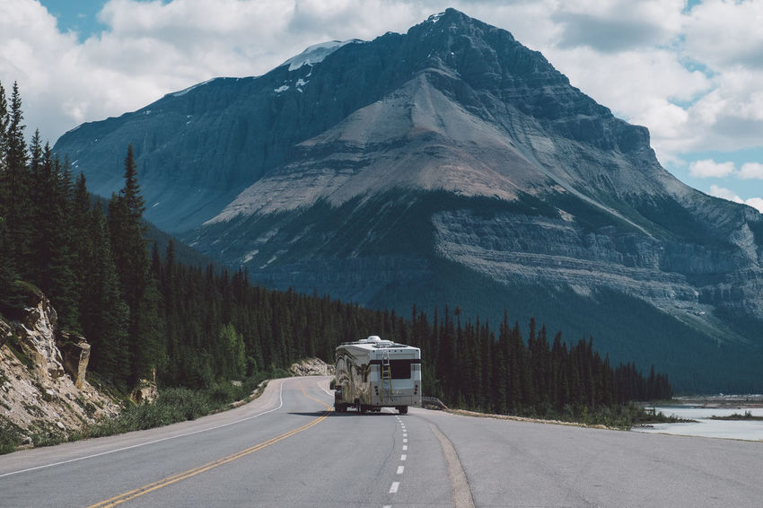 Nature Wohnmobil Camper Campervan Cloud - Sky Day Glacier Land Vehicle Mode Of Transport Mountain Mountain Range Mountains Nature Nature_collection No People Outdoors Road Scenics Semi-truck Sky Snow Snowcapped Mountain The Way Forward Transportation Tree