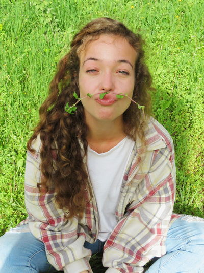 Funny Funny Faces Funny Face Green Curly Hair Mustache Grass One Person Front View Portrait Young Adult Day Young Women One Woman Only Looking At Camera People One Young Woman Only Happiness Smiling Outdoors Only Women Relaxation Lifestyles Press For Progress Summer Exploratorium