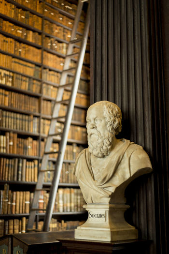 Book of Kells, Dublin Ancient Library Philosophy Sócrates Trinity College Dublin Art And Craft Book Bookshelf College Day Greek Philosophy Human Representation Indoors  Knowledge Library Male Likeness No People Old Philosopher Sculpture Spirituality Statue Trinity College