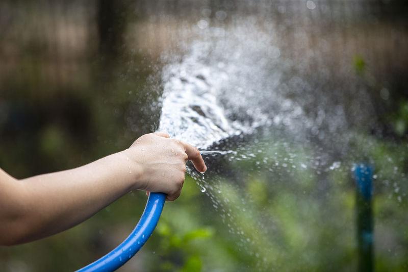 Midsection of man splashing water