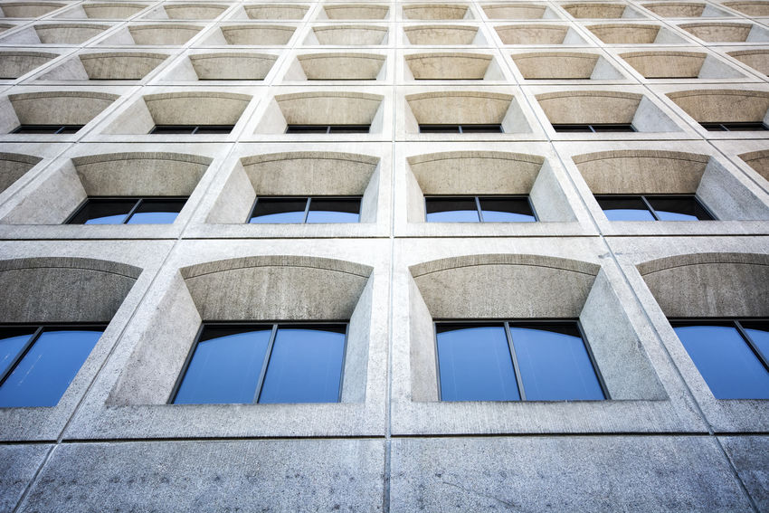 Bank facade in Downtown Eugene, Oregon. Architectural Feature Architecture Backgrounds Building Building Exterior Built Structure City Day Façade Geometric Shape Low Angle View Modern No People Office Building Outdoors Reflection Repetition Tall - High