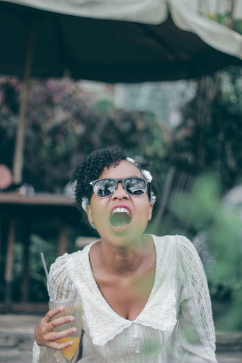 Unawares faces Teenager Fresh EyeEm Best Shots EyeEm Gallery EyeEm Best Edits Young Women Protruding Eyeglasses  Women Portrait Happiness Mouth Open Front View Sunglasses Standing Human Tongue Shouting Screaming Making A Face Visual Creativity