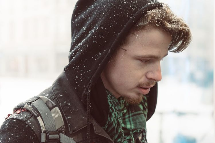 EyeEm Selects Focus On Foreground Real People Winter One Person Headshot Serious Lifestyles Close-up Cold Temperature Warm Clothing Side View Leisure Activity Mid Adult Outdoors Young Adult Jacket Day Snow Nature