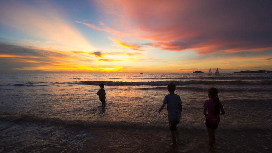 kids on a beach Sunset Sky Sea Water Beach Land Cloud - Sky Beauty In Nature Horizon Scenics - Nature Togetherness Horizon Over Water Orange Color Men Outdoors