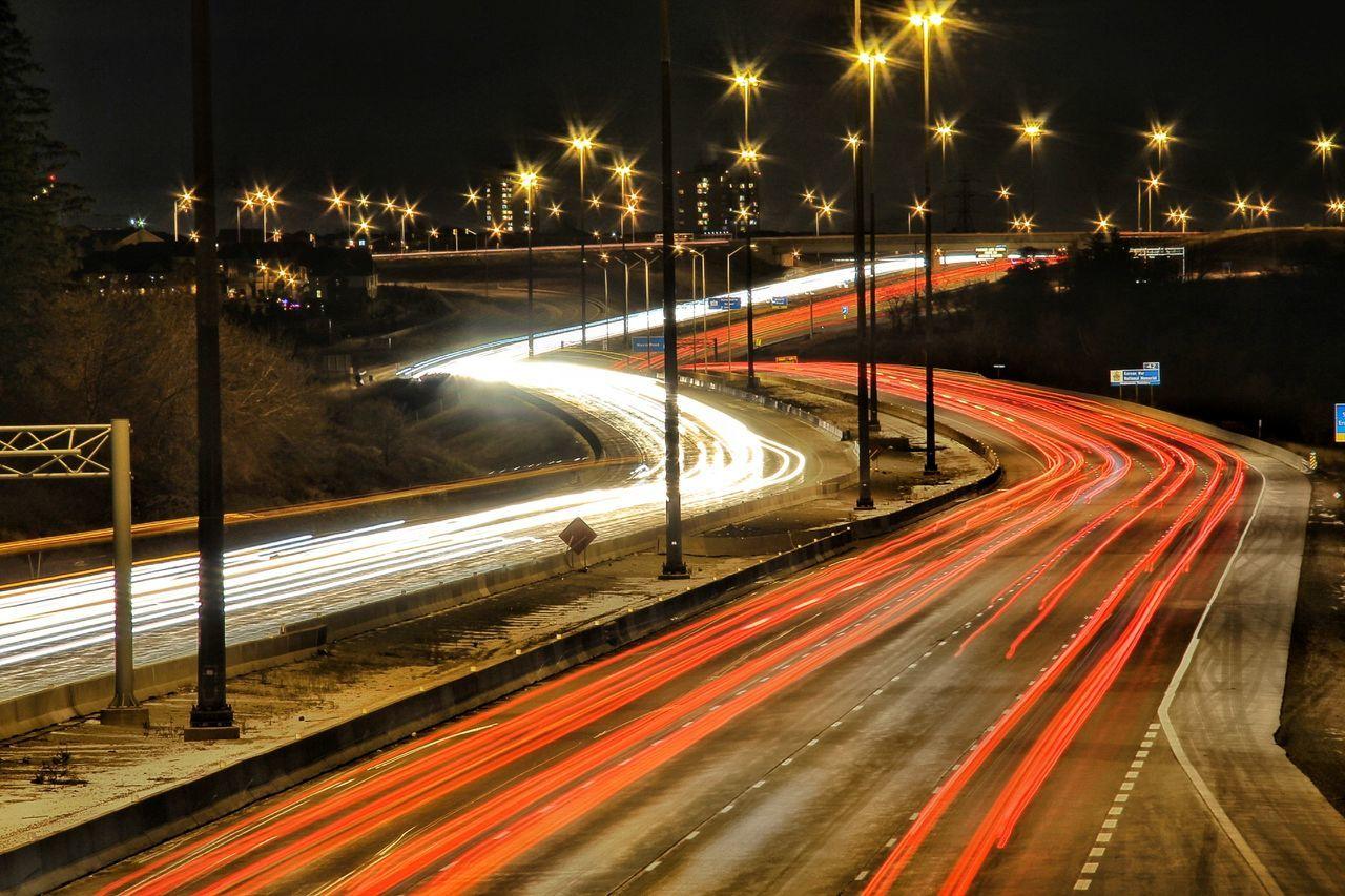 speed, illuminated, night, light trail, transportation, motion, long exposure, road, high street, traffic, street light, street, blurred motion, no people, outdoors, urban scene, city