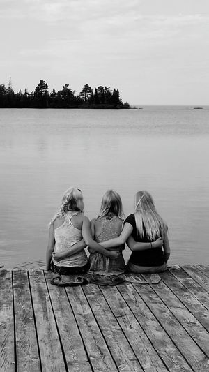 Monochrome Photography Water Sitting Togetherness Tree Relaxation Rear View Horizon Over Water Sea Tranquility Tranquil Scene Childhood Sky Scenics Idyllic Vacations Summer Person Pier Nature Day Harbor Copper Harbor