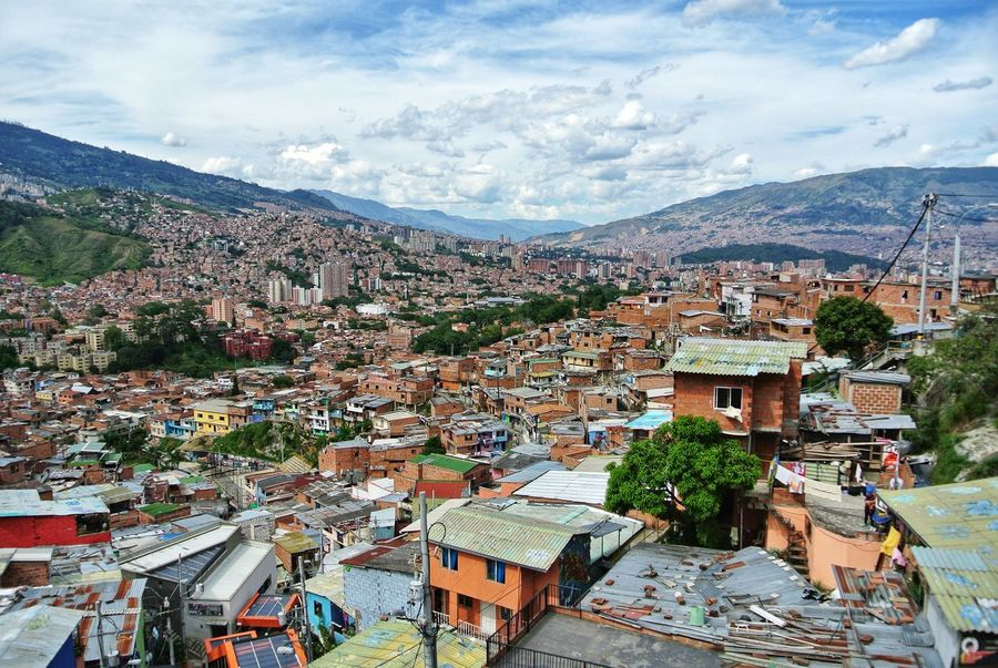 Comuna 13. Medellin. 🇨🇴 San Javier Escalator Farc Pablo Escobar Barrio Comuna History Change Antioquia Comuna 13 Medellín Colombia Graffiti Streetart Streetphotography Colorful South America Latin America Cityscape City Mountain Tree Roof Town High Angle View Community Sky Architecture TOWNSCAPE Rooftop